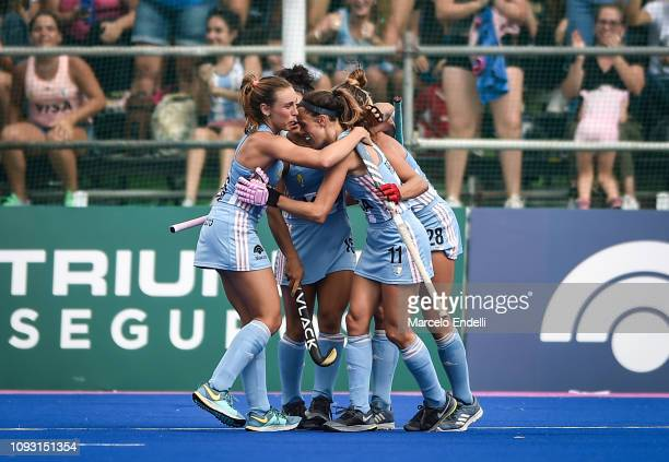 Carla Rebecchi of Argentina celebrates with teammates after scoring the first goal of his team during the Women's FIH Field Hockey Pro League match...