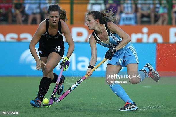 Carla Rebecchi of Argentina competes with Rose Keddell of New Zealand during the final match between Argentina and New Zealand on day 9 of the Hockey...
