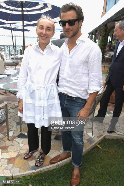 Carla Sozzani and Francesco Carrozzini attend an intimate lunch hosted by Livia Firth Carlo Capasa and Caroline Scheufele to announce Chopard as...