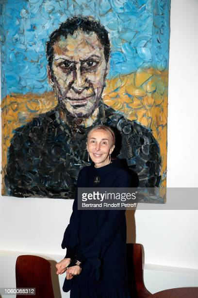 Carla Sozzani poses in front of a portrait of Azzedine Alaia by Julian Schnabel during Alaia Foundation Library Opening at Gallery Azzedine Alaia on...