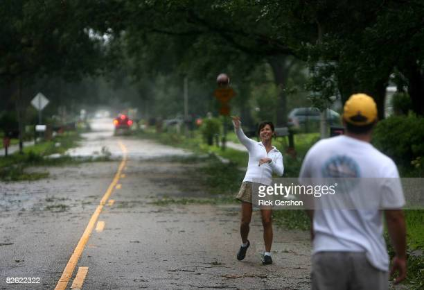 Carla Stephenson and Michael Corry play catch in the street shortly after Hurricane Gustav passed through September 1 2008 in Lafayette Louisiana The...