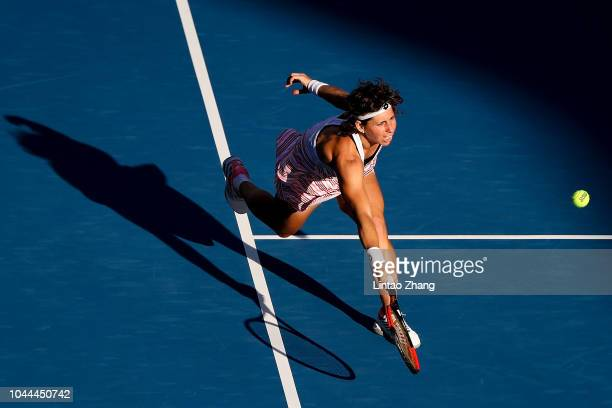 Carla Suarez Navarro of Spain hits a return against Angelique Kerber of Germany during their Woen's Singles 2nd Round match of the 2018 China Open at...