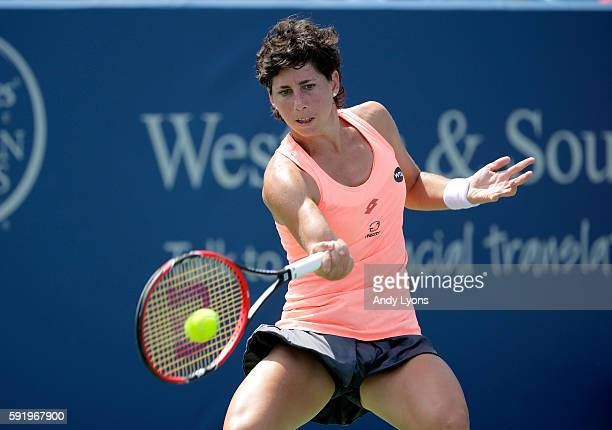 Carla Suarez Navarro of Spain hits a return during her quarterfinal match against Angelique Kerber during day 7 of the Western Southern Open at the...