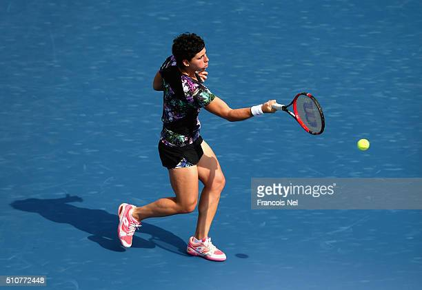 Carla Suarez Navarro of Spain in action in her match against Caroline Garcia of France during day three of the WTA Dubai Duty Free Tennis...