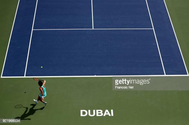 Carla Suarez Navarro of Spain plays a backhand during day three of the WTA Dubai Duty Free Tennis Championship at the Dubai Tennis Stadiumon February...