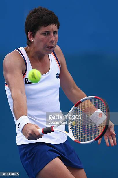 Carla Suarez Navarro of Spain plays a backhand in her match against Ekaterina Makarova of Russia during day three of the 2014 Sydney International at...