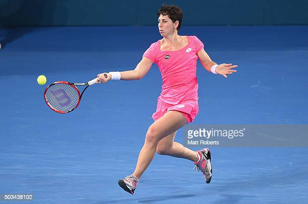 Carla Suarez Navarro of Spain plays a forehand against Sam Stosur of Australia during day three of the 2016 Brisbane International at Pat Rafter...