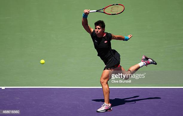 Carla Suarez Navarro of Spain plays a forehand against Serena Williams of the United States in the final during the Miami Open Presented by Itau at...