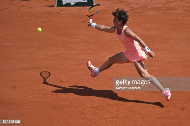 Carla Suarez Navarro of Spain plays a forehand during the women's singles fourth round match against Simona Halep of Romania on day nine of the 2017...