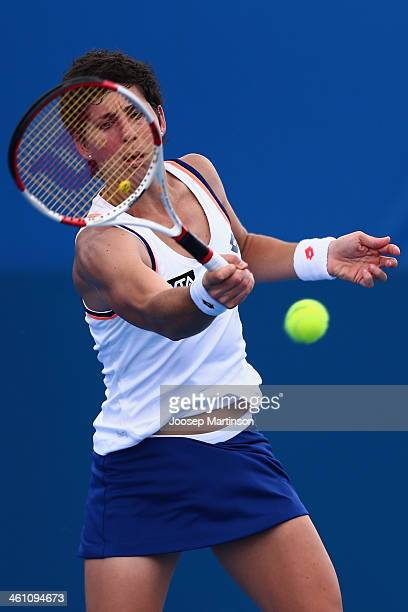 Carla Suarez Navarro of Spain plays a forehand in her match against Ekaterina Makarova of Russia during day three of the 2014 Sydney International at...