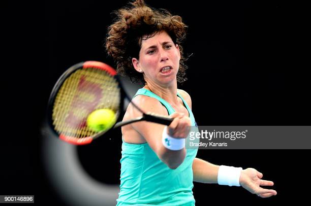 Carla Suarez Navarro of Spain plays a forehand in her match against Elina Svitolina of Ukraine during day two of the 2018 Brisbane International at...