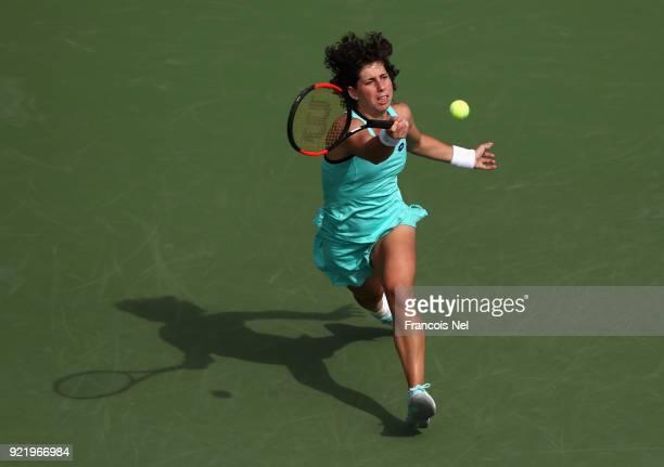 Carla Suarez Navarro of Spain plays a forehand in her match against Karolina Ploskova of Czech Republic during day three of the WTA Dubai Duty Free...