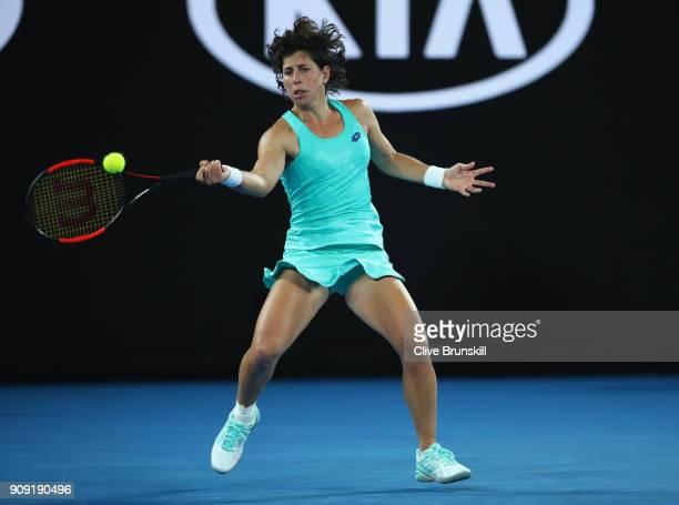 Carla Suarez Navarro of Spain plays a forehand in her quarterfinal match against Caroline Wozniacki of Denmark on day nine of the 2018 Australian...