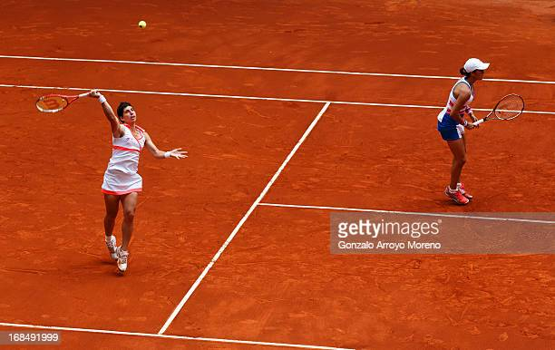 Carla Suarez Navarro of Spain plays a high ball besides her doubles partner Silvia SolerEspinosa of Spain on day seven of the Mutua Madrid Open...