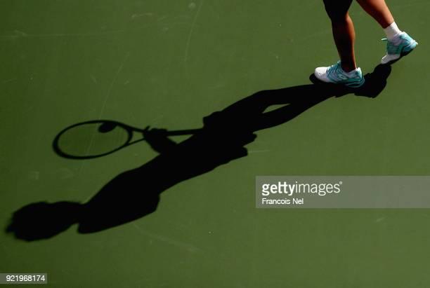 Carla Suarez Navarro of Spain prepares to serve during day three of the WTA Dubai Duty Free Tennis Championship at the Dubai Tennis Stadiumon...