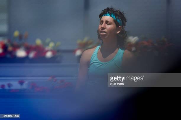 Carla Suarez Navarro of Spain reacts in her match against Caroline Garcia of France during day six of the Mutua Madrid Open tennis tournament at the...