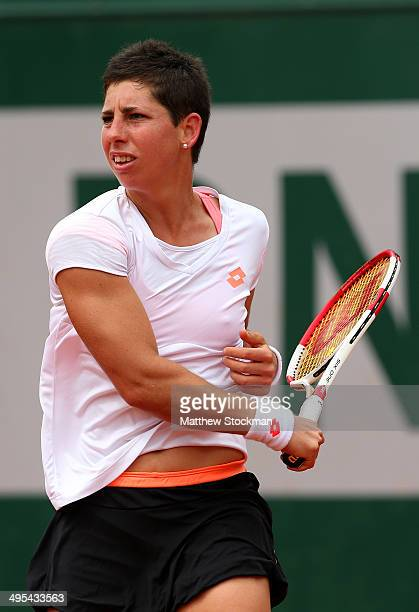 Carla Suarez Navarro of Spain returns a shot during her women's singles quarterfinal match against Eugenie Bouchard of Canada on day ten of the...