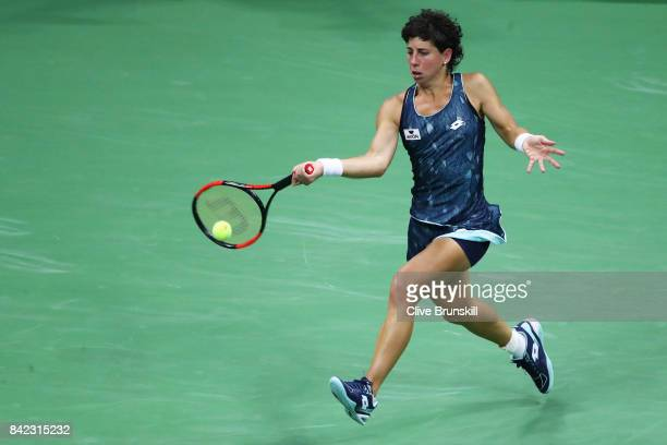 Carla Suarez Navarro of Spain returns a shot during her women's singles fourth round match against Venus Williams of the United States on Day Seven...