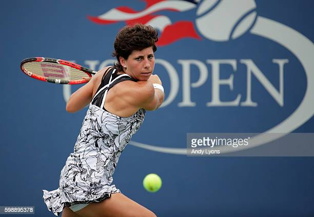 Carla Suarez Navarro of Spain returns a shot to Elena Vesnina of Russia during her third round Women's Singles match on Day Six of the 2016 US Open...