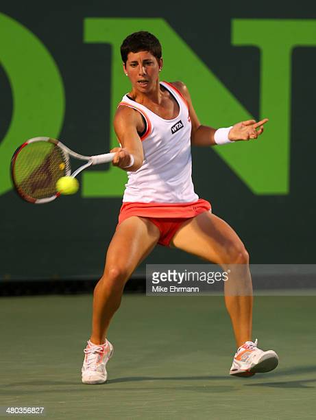 Carla Suarez Navarro of Spain returns a shot to Li Na of China during their match on March 24 2014 in Key Biscayne Florida