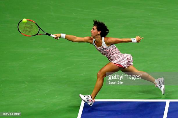 Carla Suarez Navarro of Spain returns the ball during her women's singles quarterfinal match against Madison Keys of the United States on Day Ten of...