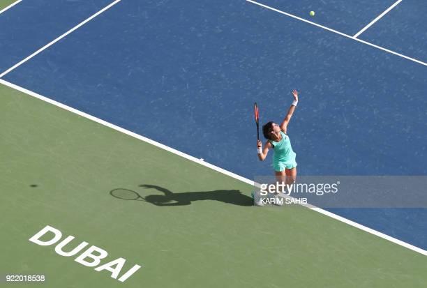TOPSHOT Carla Suarez Navarro of Spain returns the ball to Karolina Pliskova of the Czech Republic during day two of the WTA Dubai Duty Free Tennis...