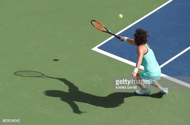 Carla Suarez Navarro of Spain returns the ball to Karolina Pliskova of the Czech Republic during day two of the WTA Dubai Duty Free Tennis...