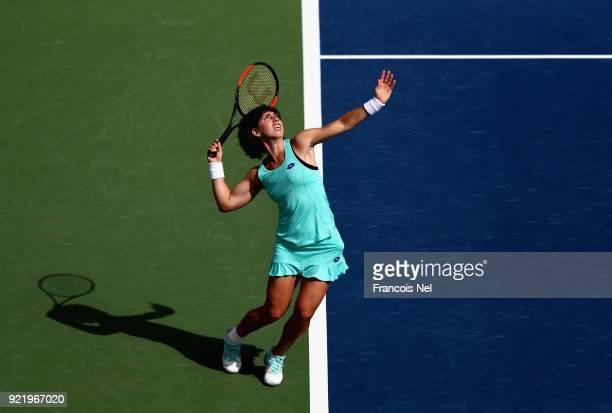 Carla Suarez Navarro of Spain serves against Karolina Ploskova of Czech Republic during day three of the WTA Dubai Duty Free Tennis Championship at...