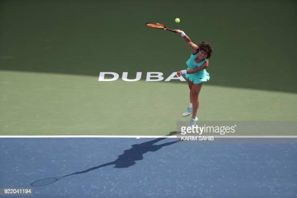 Carla Suarez Navarro of Spain serves the ball to Karolina Pliskova of the Czech Republic during day two of the WTA Dubai Duty Free Tennis...