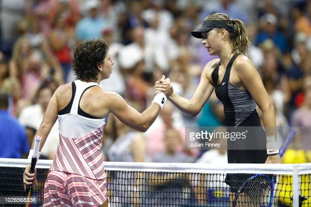 Carla Suarez Nevarro of Spain shakes hands with her opponant Maria Sharapova of Russia following their women's singles fourth round match on Day...