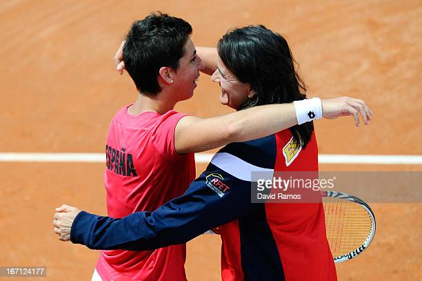 Carla Suarez of Spain celebrates with her captain Conchita Martinez of Spain after winning her match against Ayumi Morita of Japan during the day two...