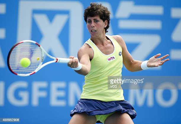 Carla Suarez of Spain competes with Caroline Wozniacki of Denmark during day three of the 2014 Dongfeng Motor Wuhan Open at Optics Valley...