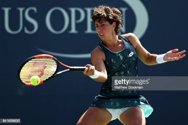Carla SuarezNavarro of Spain returns a shot to Ekaterina Makarova of Russia during their third round match on Day Five of the 2017 US Open at the...