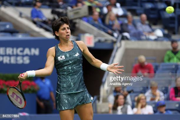 Carla Suárez Navarro of Spain competes against Venus Williams of the United States in Women's Singles round four tennis match within the 2017 US Open...