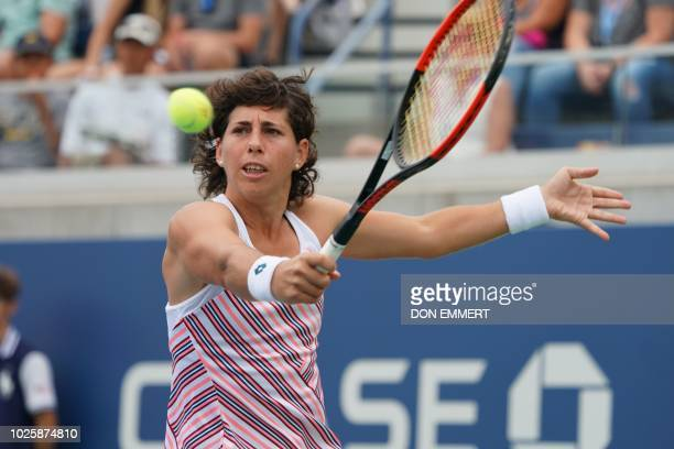 Carla Suárez Navarro of Spain hits a return to Caroline Garcia of France during their 2018 US Open women's round 3 match September 1 2018 in New York