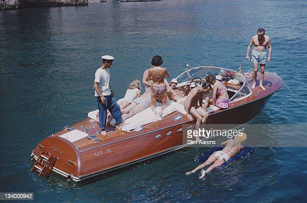 Carla Vuccino and Bianca Volpato holiday with their friends on Capri, Italy, July 1958.