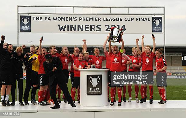 Carla Ward of Sheffield FC Ladies lifts the trophy after winning the FA Women's Premier League Cup Final between Cardiff City Ladies and Sheffield FC...
