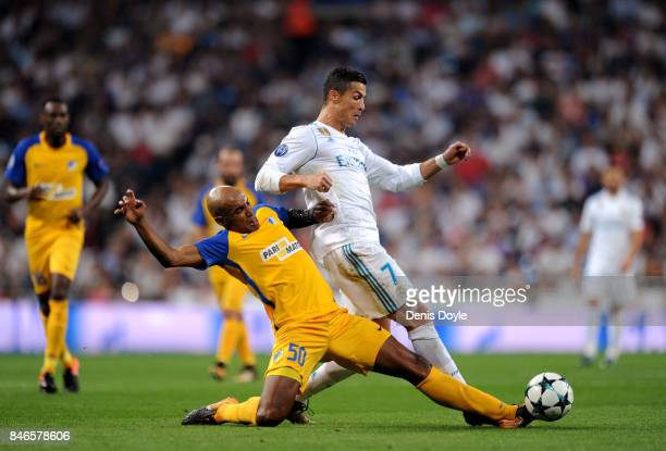 Carlao of Apoel FC tackles Cristiano Ronaldo of Real Madrid during the UEFA Champions League group H match between Real Madrid and APOEL Nikosia at...