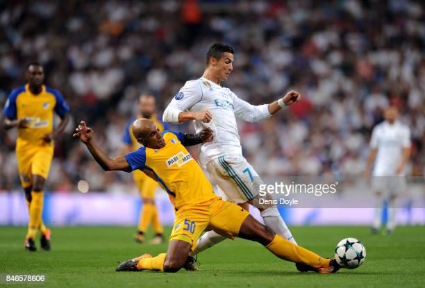 Carlao of Apoel FC tackles Cristiano Ronaldo of Real Madrid during the UEFA Champions League group H match between Real Madrid and APOEL Nikosia at...
