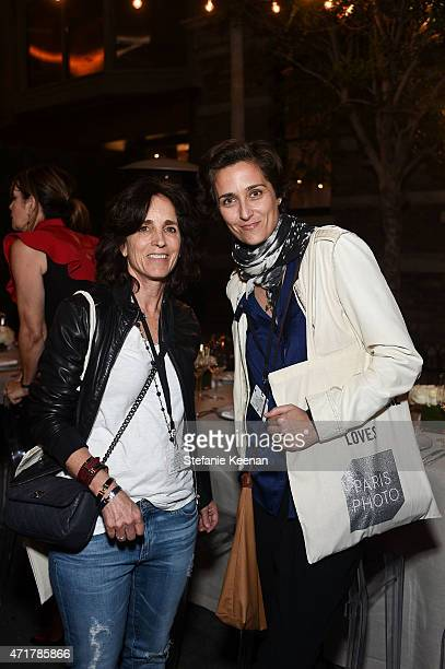 Carleen Cappelletti and Alexandra Hedison attend Paris Photo Los Angeles UTA Reception at Paramount Studios on April 30 2015 in Los Angeles California
