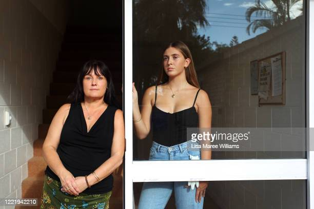 Carlene O'Loughlin and daughter Tiahne O'LoughlinJohnson stand inside the doorway of their home on March 31 2020 on the Sunshine Coast Australia...