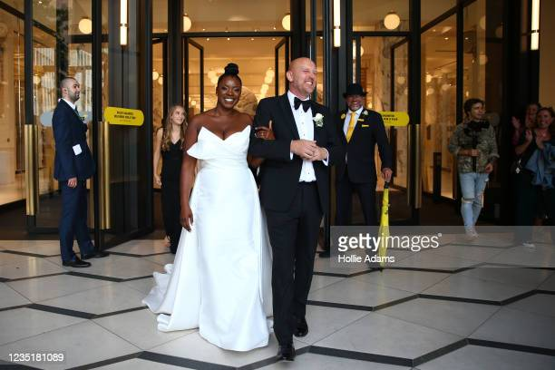 Carlene Sains and Danny Sains pose for photos at Selfridges on September 11, 2021 in London, England. Their wedding was the first to be hosted in the...