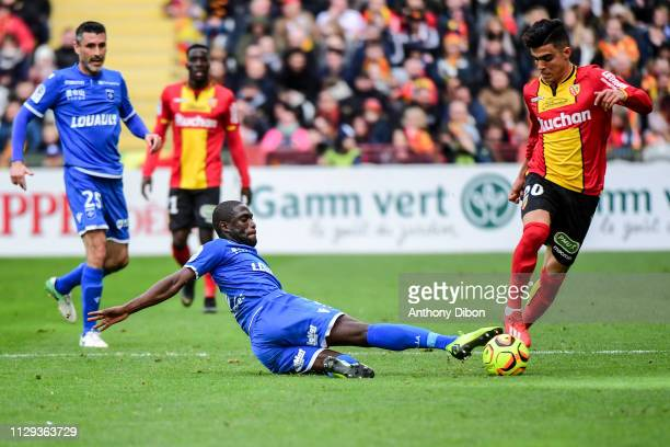 Carlens Aruc of Auxerre and Achraf Bencharki of Lens during the Ligue 2 match between RC Lens and AJ Auxerre at Stade BollaertDelelis on March 9 2019...