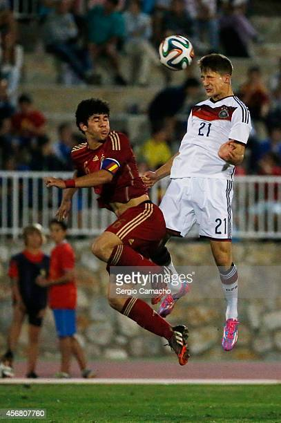 Carles Alea Castillo of Spain challenges Salih zcan of Germany during the international friendly match between U17 Spain and U17 Germany at Campo...