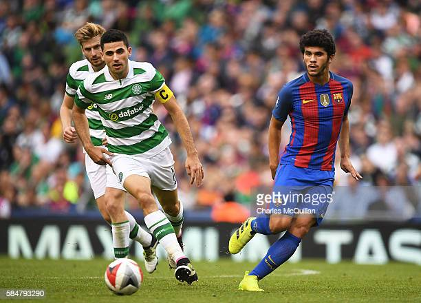 Carles Alena of Barcelona and Tomas Rogic of Celtic during the International Champions Cup series match between Barcelona and Celtic at Aviva Stadium...