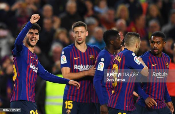Carles Alena of Barcelona celebrates as he scores his team's second goal with team mates during the La Liga match between FC Barcelona and Villarreal...