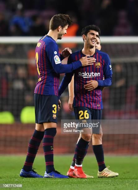 Carles Alena of Barcelona celebrates with team mate Gerard Pique after the La Liga match between FC Barcelona and Villarreal CF at Camp Nou on...