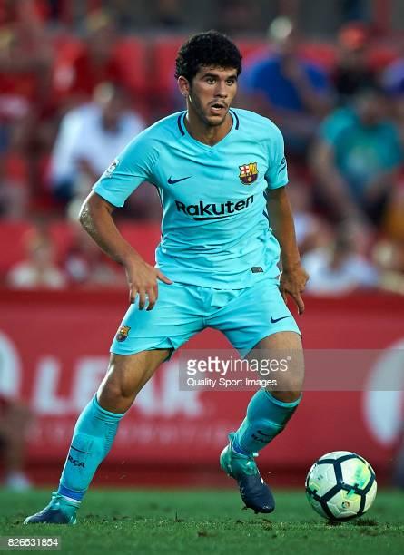 Carles Alena of Barcelona in action during the preseason friendly match between Gimnastic de Tarragona and FC Barcelona at Nou Estadi de Tarragona on...