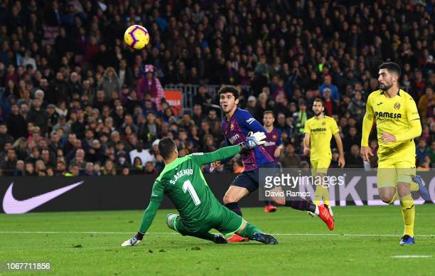 Carles Alena of Barcelona scores his team's second goal past Sergio Asenjo of Villareal during the La Liga match between FC Barcelona and Villarreal...