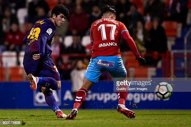 Carles Alena of FC Barcelona B is challenged by Jose Luis Munoz of CD Lugo during the La Liga 123 match between CD Lugo and FC Barcelona B at Angel...